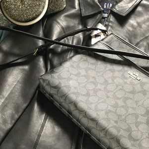 Monogrammed Coach bag and A Gap leather Jacket